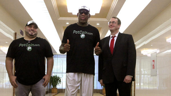 Former NBA star Dennis Rodman poses with his entourage — Chris Volo (left) and Joe Terwilliger — after arriving at Pyongyang Sunan International Airport in North Korea on Tuesday for Rodman's first visit to North Korea since President Trump took office.