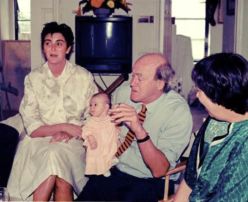 Roald Dahl holds his infant granddaughter, Chloe. Lucy Dahl is pictured at left.