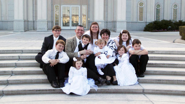 Dawn Poole and her husband have to regularly document their family finances to make sure their nine children, who all have complex health conditions, continue to qualify for Medicaid.