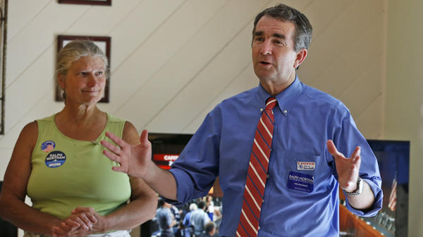 Democratic candidate for governor, Lt. Gov. Ralph Northam, greets voters on Tuesday in Chesterfield, Va.