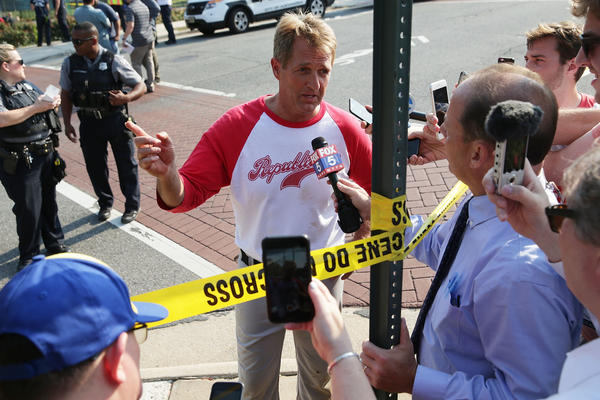 U.S. Sen. Jeff Flake, R-Ariz., briefs members of the media near ballfield where a shooting took place on Wednesday in Alexandria, Va. U.S. House Majority Whip Rep. Steve Scalise, R-La., and several other people were shot by a gunman during a Republican baseball practice.