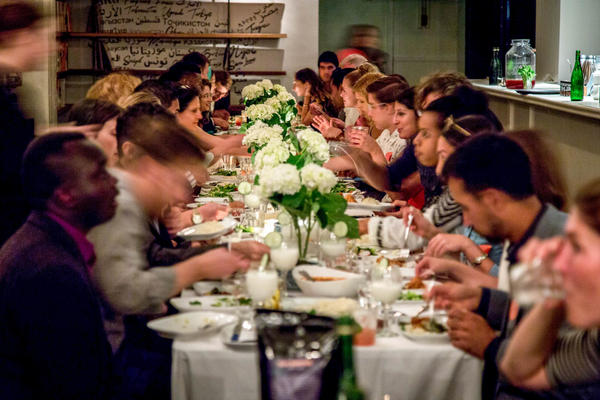 Guests attend a Refugees Welcome dinner at Lapis restaurant in Washington, D.C. The goals of the evening: to bring locals together with refugees in their community and to break barriers by breaking bread.