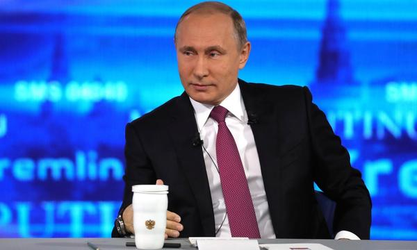Russia's President Vladimir Putin replies to a citizen's question during his annual Q&A Direct Line session on national television in Moscow.