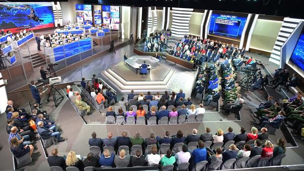 Russian President Vladimir Putin answers questions from a studio audience and citizens calling in, at his annual Direct Line session on Thursday.