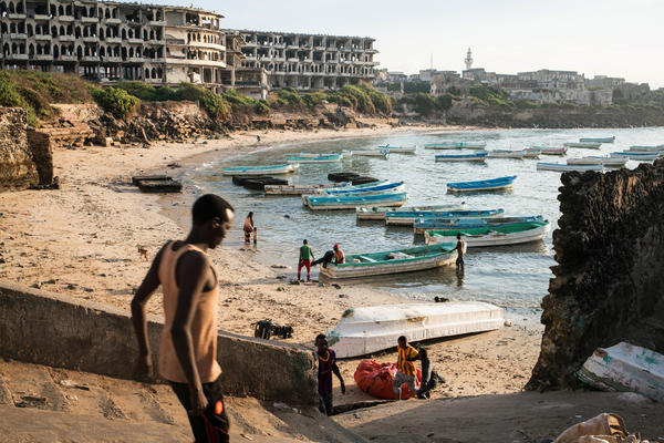 Fishing boats gather at dawn in the old port in Mogadishu, the Somali capital, in front of destroyed Aruba Hotel. Somali fishermen-turned-pirates have made the waters off the Horn of Africa one of the most treacherous places in the world for international shipping vessels.