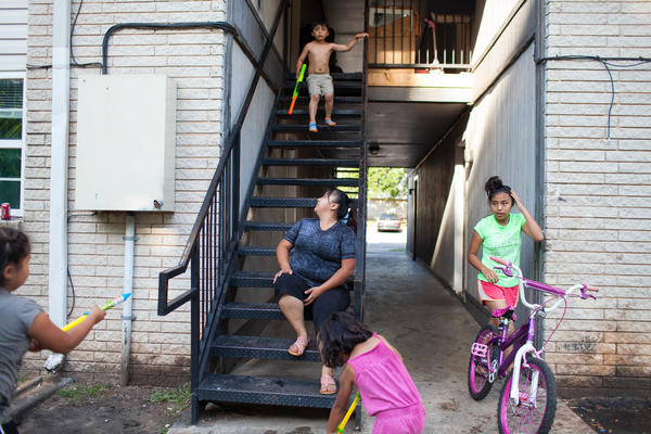 After living for almost a year at the City Rescue Mission shelter and then sleeping on couches for a few months, Ritisha and her five children finally move into low-income housing in Oklahoma City, Okla.