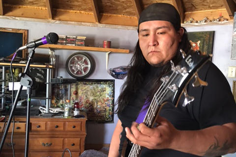 Brett Begay plays bass for I Dont Konform. He says heavy metal helps him deal with his anxiety. (Laurel Morales/Fronteras)