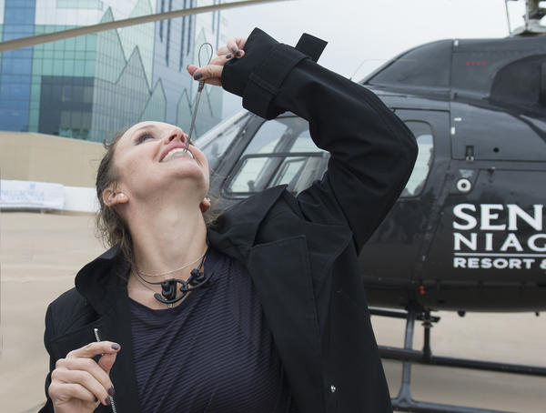 Erendira Wallenda showing off the special mouthpiece she used to hang from a helicopter by her teeth
