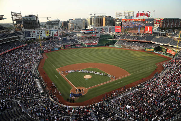 Members of the Republican and Democratic congressional baseball teams gather for a moment of silence before the Congressional Baseball Game on Thursday.