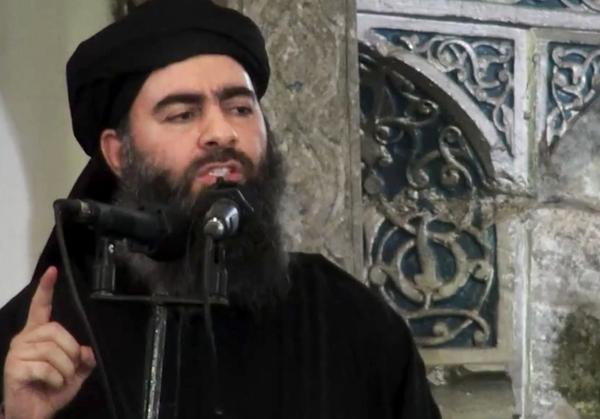 Russian officials say they have not confirmed that a strike on ISIS killed the extremist group's leader, Abu Bakr al-Baghdadi, shown in 2014.