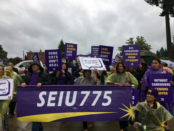 Unionized homecare workers march through Washington's Capitol campus on Thursday. They called on lawmakers not to cut their healthcare plan in the next budget.