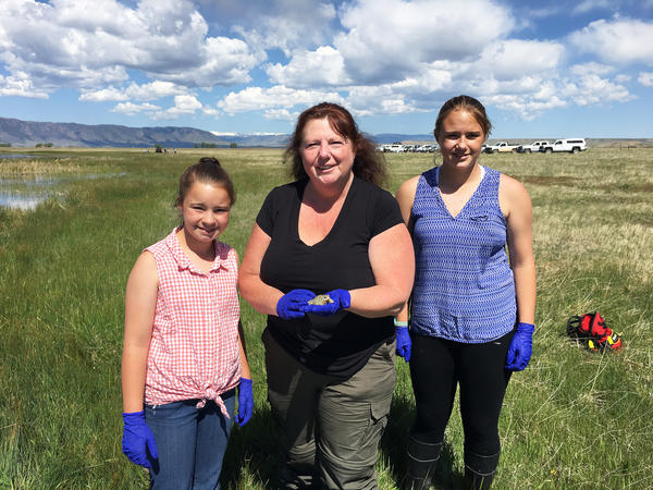 Sharon Taylor, with her daughters Christina (left) and Katelyn (right), were part of a group that reintroduced 853 Wyoming toads into the wild at Mortenson Lake National Wildlife Refuge in Laramie, Wyo.