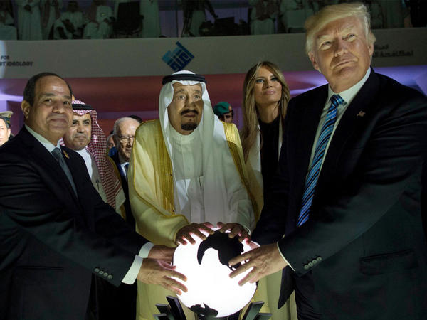 President Trump attends the Global Center for Combating Extremist Ideology, poses with the Saudi and Egyptian leaders, and touches a glowing orb during his May 2017 visit to Saudi Arabia.