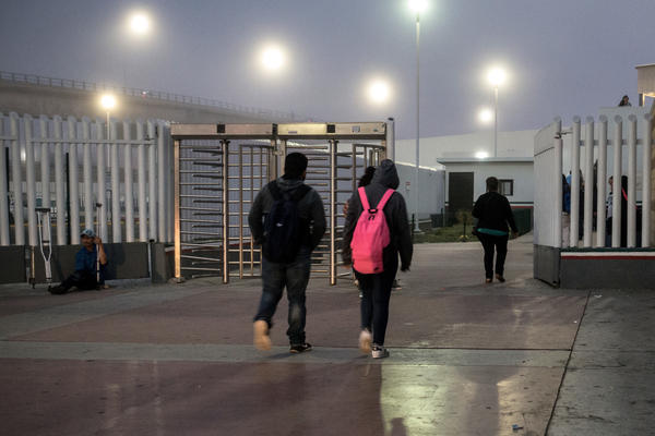 Students in Tijuana walk toward the U.S. border early in the morning on May 2. Teachers in San Diego estimate that about 1,000 students cross from Tijuana into San Diego every day to go to school.