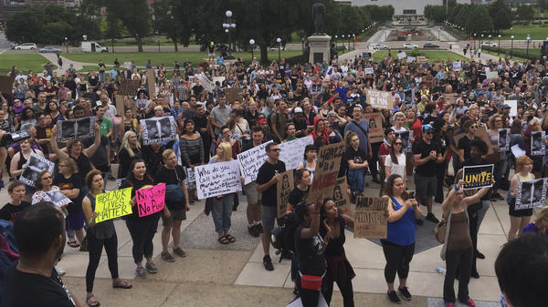 Protesters gather outside the Minnesota State Capitol in St. Paul, Minn., on Friday.