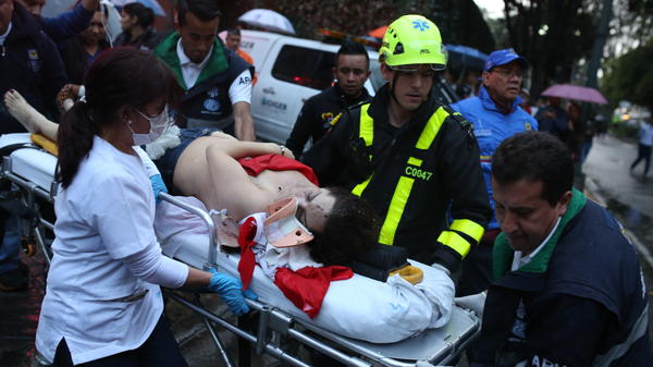A woman is taken away on a gurney after an explosion at the Andino shopping center in Bogota, Colombia, on Saturday.