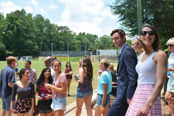 """Democrat Jon Ossoff and his fiancée, Alisha Kramer, arrive at a """"Rock Your Ossoff!"""" rally aimed at getting millennials to vote. (Sam Whitehead/GPB)"""