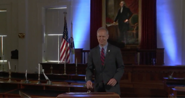 Gov. Bruce Rauner approaches a lectern Tuesday at the Old State Capitol Historic Site. He distributed a video message on the night before 10 days of special sessions he called to spur action on his economic and political agenda and a state budget.