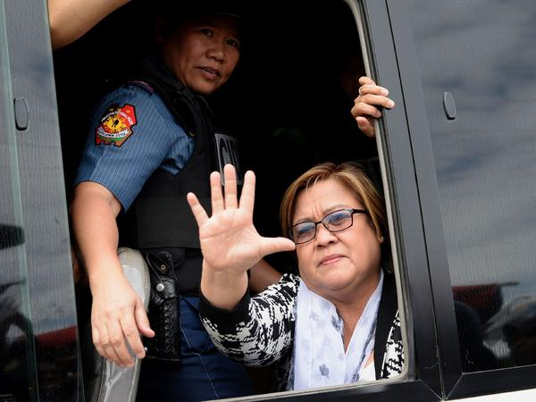 Philippine Sen. Leila de Lima, a former human rights commissioner and one of President Rodrigo Duterte's most vocal opponents, waves to supporters after appearing at a court in suburban Manila on Feb. 24. She was arrested on drug-related charges that she denies.