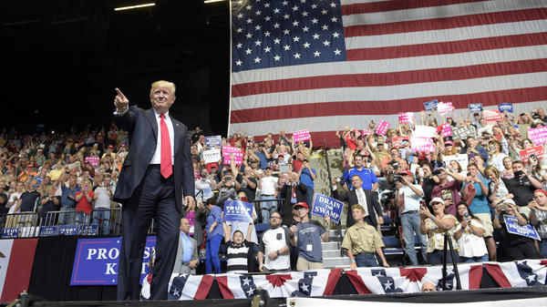 President Trump arrives on stage to speak at the U.S. Cellular Center in Cedar Rapids, Iowa, on Wednesday.