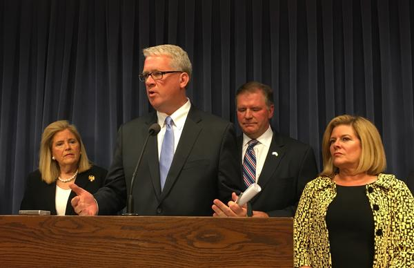 House Republican Leader Jim Durkin, second from left, speaks with reporters on June 21, 2017.