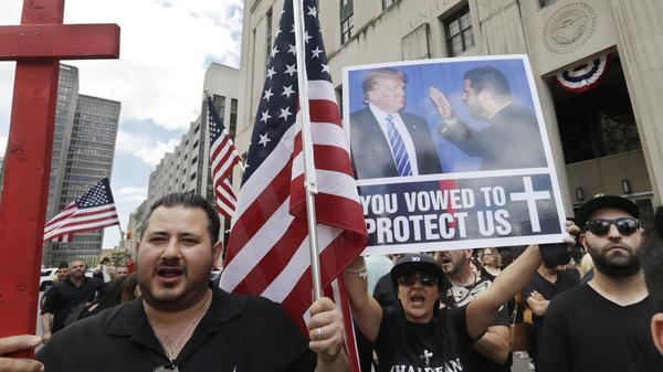Iraqis and supporters rallied outside a Detroit courthouse Wednesday as a hearing began on a lawsuit that seeks to stop the government from deporting more than 100 Iraqi nationals who were recently rounded up.