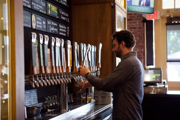 <p>A bartender pours a beer at Widmer Brothers Brewing in Portland. Widmer is one of several Oregon businesses creating an alliance to combat climate change.</p>