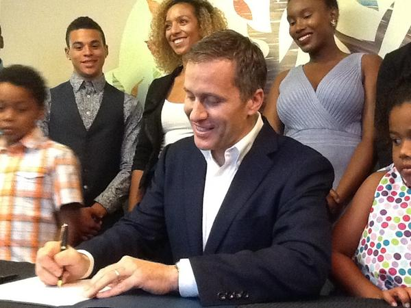 Gov. Eric Greitens signs the Foster Care Bill of Rights into law.