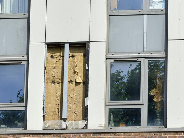 A panel of external cladding was removed from the Dorney tower block in north London. Tower blocks across England are being tested to check whether their outer coverings pose a serious fire risk following the Grenfell Tower disaster.