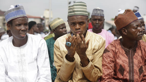 Young men offer Eid al-Fitr prayers outdoors in Lagos, Nigeria's largest city.