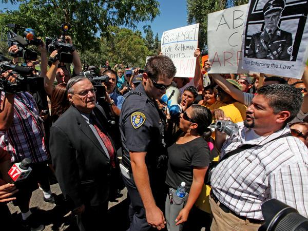 Arpaio confronts protesters during a 2010 rally in Rancho Bernardo, California.