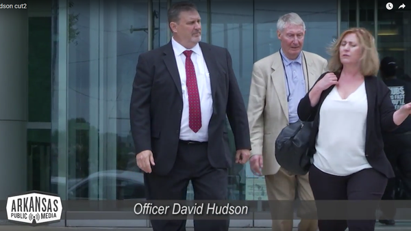 Officer David Hudson (left) with his wife and father-in-law outside the federal courthouse in Little Rock