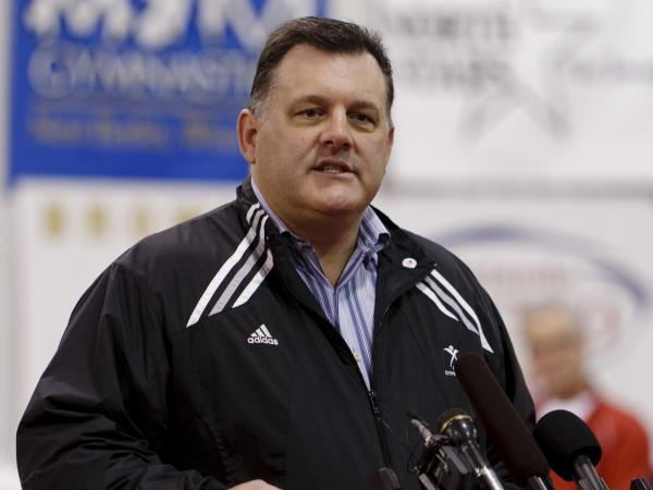 USA Gymnastics announced Tuesday it will adopt new policies to better protect its athletes from abuse. Steve Penny, the organization's former president and CEO, is seen here in 2011.