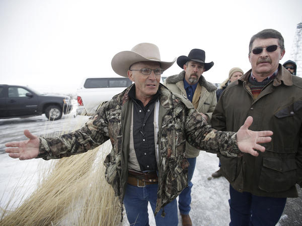 Robert LaVoy Finicum (left), a rancher from Arizona, talks to reporters at the Malheur National Wildlife Refuge near Burns, Ore., in January 2016. His shooting death by state police was found by investigators to be justified.
