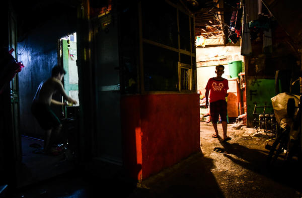 A man walks down a small street in the Arellano district of Manila.