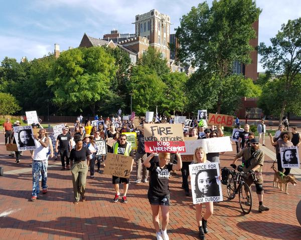 Demonstrators marched across UC's campus Wednesday June 28, 2017.