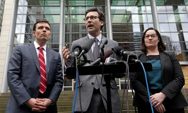 <p>Attorney General Bob Ferguson, center, stands with Solicitor General Noah Purcell, left, and Civil Rights Unit Chief Colleen Melody on Wednesday, March 15, 2017, in Seattle.</p>