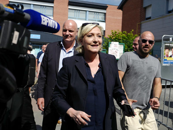 French far-right presidential candidate Marine Le Pen leaves a polling station after casting her vote in Henin Beaumont, Northern France, in parliamentary elections held earlier this month.