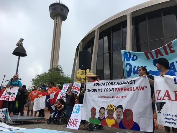 Protestors outside the San Antonio federal courthouse where U.S. District Judge Orlando Garcia heard arguments on June 26, 2017 about the constitutionality of Senate Bill 4.