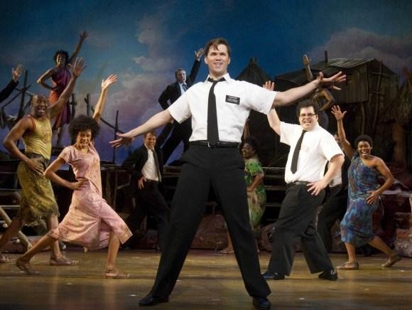 Andrew Rannells (center) and Josh Gad are two missionaries out of their depth in Northern Uganda in <em>The Book of Mormon </em>-- a new musical comedy from the creators of <em>South Park</em> and one of the men behind <em>Avenue Q.</em>