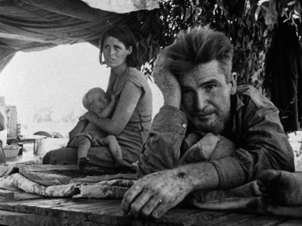 A family of migrant workers flees from the drought in Oklahoma camp by the roadside in Blythe, California, during The Great Depression.