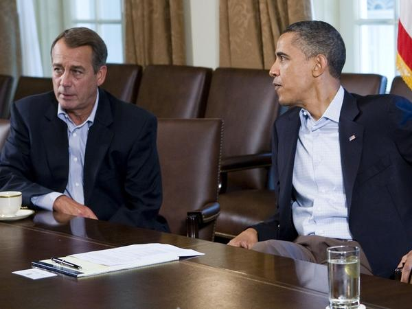 U.S. President Barack Obama (R) meets with Speaker of the House John Boehner (R-OH) (L) in the Cabinet Room of the White House