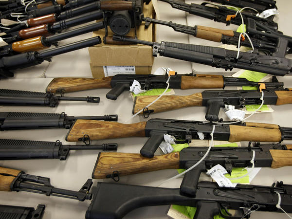 "Part of a cache of seized weapons is on display at a news conference in Phoenix in January. The ATF has been under fire over a failed gun-trafficking operation known as ""Fast and Furious,"" in which agents allegedly allowed weapons to be smuggled into Mexico."