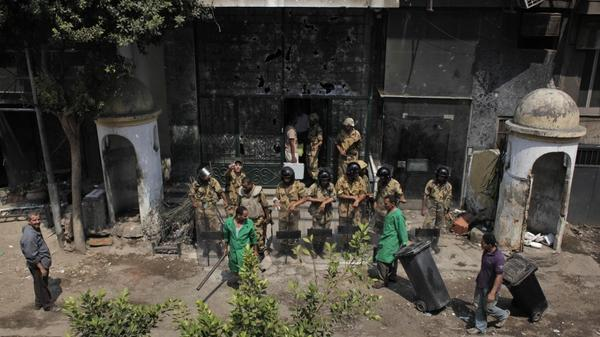 Egyptian soldiers guard the badly damaged entrance of the Israeli Embassy in Cairo on Sunday. Protesters stormed the embassy, contributing to the worst diplomatic crisis between the two countries since they signed a peace treaty in 1979.