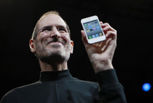 <p>Steve Jobs holds up an iPhone at the Apple Worldwide Developers Conference in San Francisco in June 2010.</p>