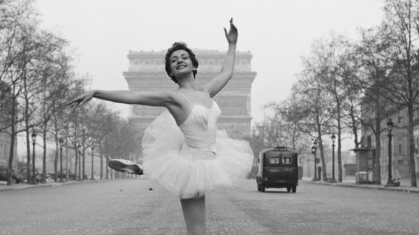 "In France,  feminists are trying to do away with the word ""mademoiselle,"" which they  see as separating women into two categories — married and unmarried — in  a manner men aren't subjected to. In this photo from 1955, ballerina Christianne Gaulthier, a dancer at the Moulin Rouge, dances through the deserted streets of Paris at the  crack of dawn. But was she a mademoiselle or madame?"