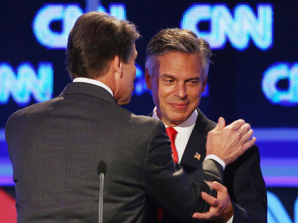 "<p>Former Utah Gov. Jon Huntsman (right) and Texas Gov. Rick Perry confer during a break in the Sept. 12 presidential debate in Tampa. Huntsman first objected to Perry's use of the word ""treasonous"" then later used it himself. </p>"