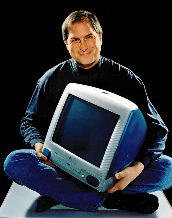 <p>Apple CEO Steve Jobs poses with an iMac in 1998.</p>
