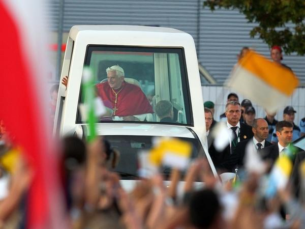"<p>Pope Benedict XVI rides in his popemobile through Freiburg im Breisgau, Germany, last month. The Vatican has released a document on world economics, condemning ""idolatry of the market.""</p>"