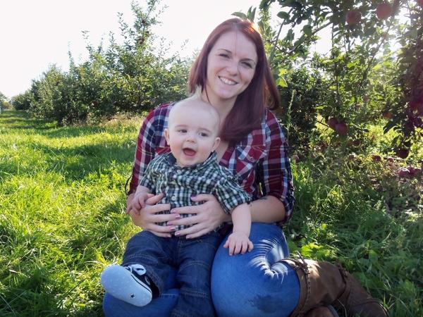 A former Marine herself, Kait Wyatt (seen with son Michael at an apple orchard in New York) says she is still struggling with the meaning of her husband's death. She knows he died doing what he believed in — and yet mourns the loss of her husband, and of her son's father.